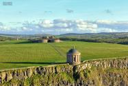 Mussenden Temple is a small circular building located on cliffs near Benone. Operated by the National Trust, there is a charge at the gate, unless you go after hours. They close at 5pm, but the grounds are still accessible to the public from the carpark.
